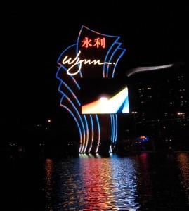 Wynn sign reflecting on lake Macau China