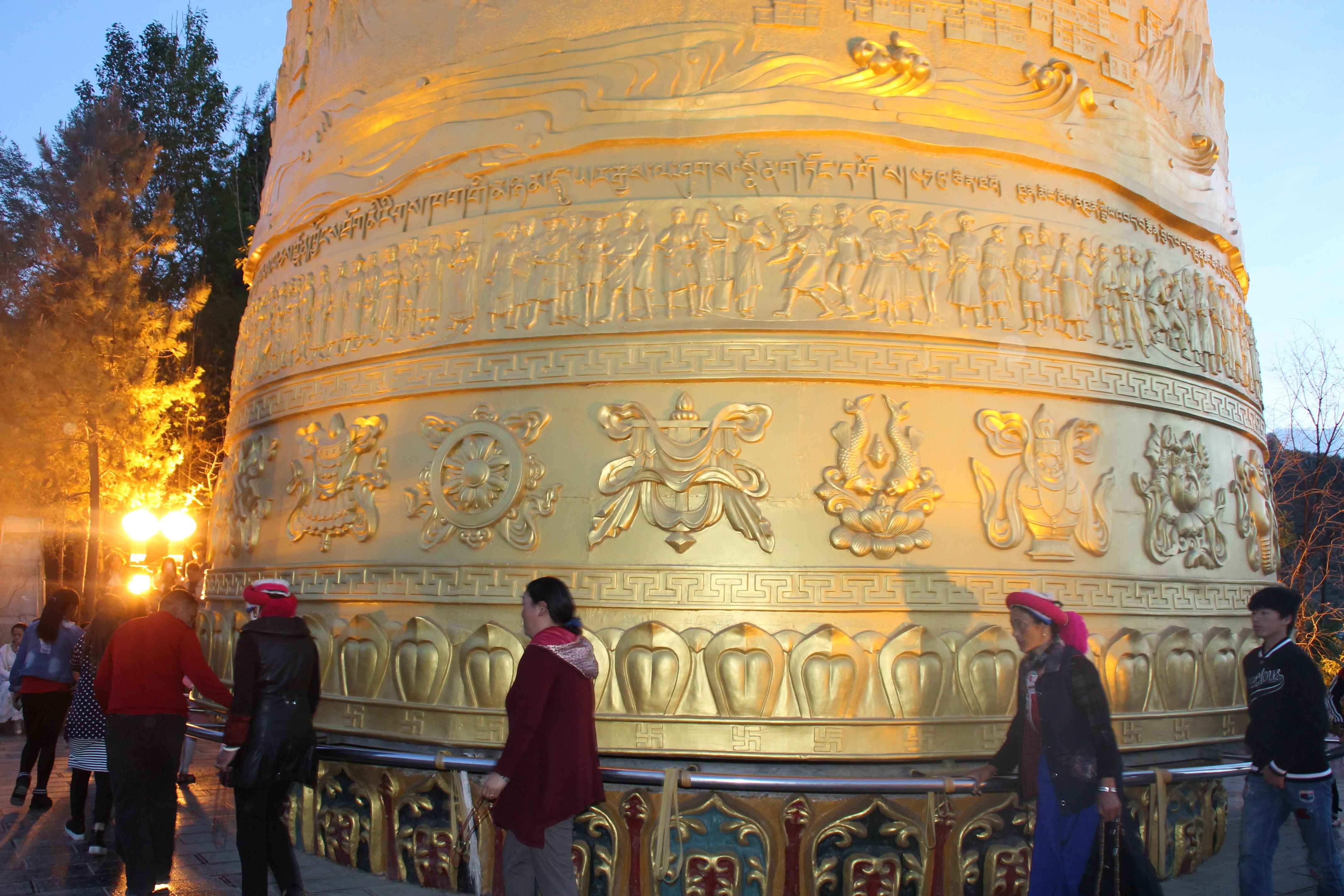 locals spinning prayer wheel shangrila china