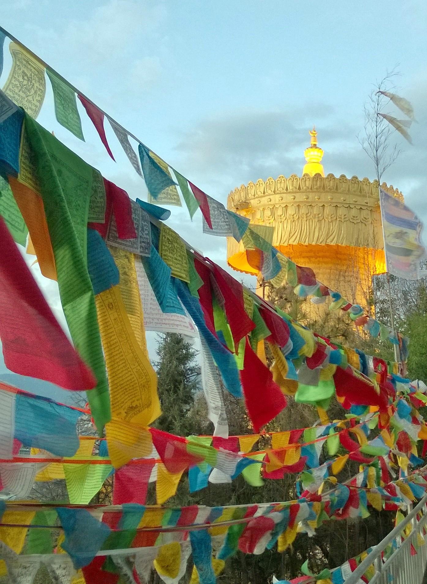 prayer flags outside prayer wheel